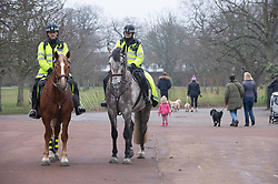 © Licensed to London News Pictures 08/01/2021.         Greenwich, UK. Mounted Metropolitan police officers on patrol in Greenwich park in London during a third national Covid lockdown. Photo credit:Grant Falvey/LNP