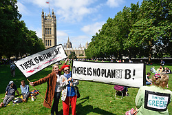 "© Licensed to London News Pictures. 26/06/2019. LONDON, UK.  People take part in a ""Time Is Now"" mass lobby around Parliament.  Activists are attempting to deliver a message to MPs that to tackle the environmental crisis, a strong Environment Bill is passed that can restore nature, cut plastic pollution and improve air quality.  Similar gatherings are taking place across the UK.   Photo credit: Stephen Chung/LNP"