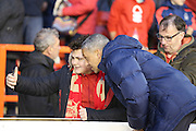 Brighton Manager, Chris Hughton with a fan having a selfie during the Sky Bet Championship match between Nottingham Forest and Brighton and Hove Albion at the City Ground, Nottingham, England on 11 April 2016. Photo by Simon Davies.