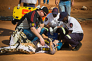 Mienie Donavan (RSA) receives medical attention after a fall during the practice round at the UCI BMX Supercross World Cup, Pietermaritzburg, 2011