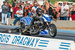 "Steve ""Doc"" Hopkins of Doc's Harley-Davidson off the line at the Sturgis Drag Race Finals on Wednesday during the annual Sturgis Black Hills Motorcycle Rally. SD, USA. August 6, 2014.  Photography ©2014 Michael Lichter."