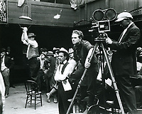 1916 Movie making at American Film Co., Santa Barbara, CA. Director Frank Borzage has his hand on the camera tripod.