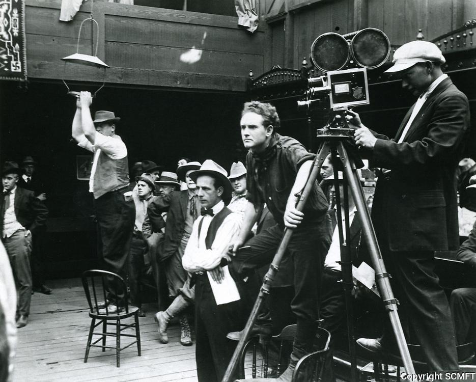 1916 Movie making at American Film Co., Santa Barbara, CA. Director Frank Borzage has his hand on the camera tripod.
