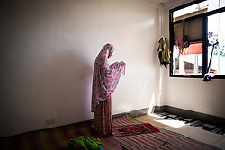 June 5, 2017 - Marawi, Philippines - Displaced muslim woman offer a prayer while living in a temporary evacuation center at Provincial Capitol Complex while government troops are trying to recover other families who are left behind in the outskirts of Marawi City in southern Philippines, June 5, 2017. (Credit Image: © Richard Atrero De Guzman/NurPhoto via ZUMA Press)