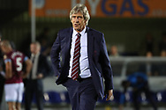 West Ham United manager Manuel Pellegrini walking off the pitch during the EFL Carabao Cup 2nd round match between AFC Wimbledon and West Ham United at the Cherry Red Records Stadium, Kingston, England on 28 August 2018.