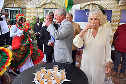 The Prince of Wales and the Duchess of Cornwall at a market in St. George's during a one day visit to the Caribbean island of Grenada.