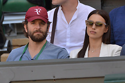 © Licensed to London News Pictures. 06/07/2016.  BRADLEY COOPER and girlfriend IRINA SHAYK watch tennis on the centre court on the tenth day of the WIMBLEDON Lawn Tennis Championships. London, UK. Photo credit: Ray Tang/LNP