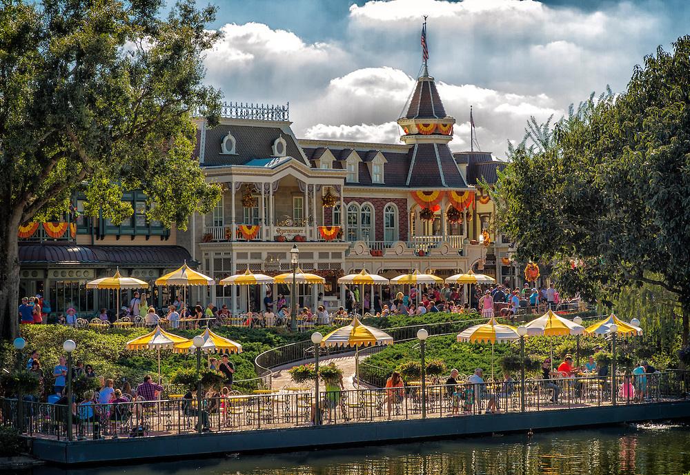 Families enjoying a beautiful day at Disney World during the Halloween week.