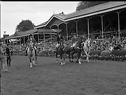 Aga Khan Trophy..1979..10.08.1979..08.10.1979..10th August 1979..The annual staging of the Aga Khan Cup took place  at the Royal Dublin Showgrounds, Ballsbridge,Dublin today.It was the first time since 1937 that Ireland won the trophy outright. The winning Irish team comprised of Paul Darragh,Capt Con Power,James Kernan and Eddie Macken..Image shows one of the competing teams parading in front of the main stand in the R.D.S. Dublin.