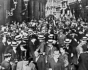 Crowds in financial district, London, during the days of tension.