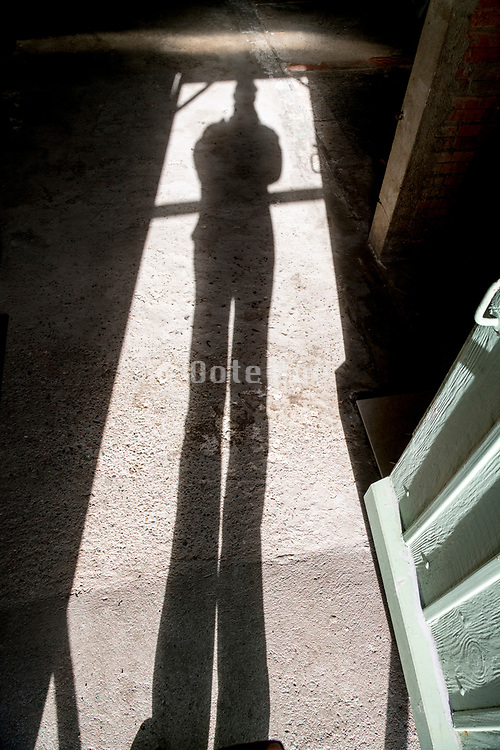very long shadow of person standing in the door entrance