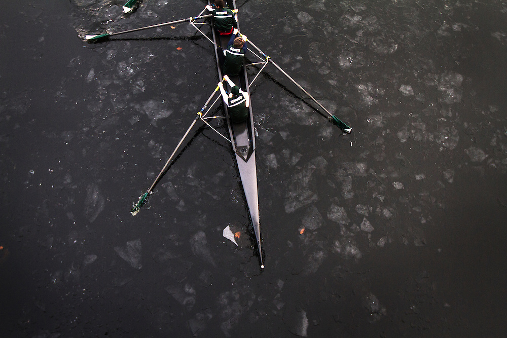 """The Dartmouth Rowing Crew hits The Connecticut River for the first time this season during crew practice on February 27, 2012. Dan Roock, Head Coach for the Light Weight Crew Team, said that, """"nobody can actually remember rowing ever in February, this might be the earliest Dartmouth has ever rowed."""""""