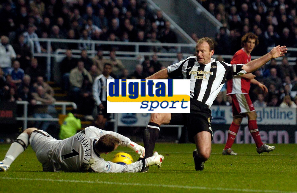 Photo: Jed Wee.<br />Newcastle United v Middlesbrough. The Barclays Premiership. 02/01/2006.<br />Newcastle's Alan Shearer (R) is just beaten to the ball by Middlesbrough goalkeeper Mark Schwarzer as he looks for his 200th goal.