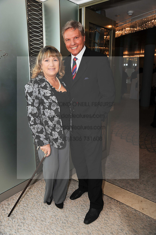 Singer JESS CONRAD and his wife RENE at the Lady Taverners Tribute Lunch in honour of Nicholas Parsons held at The Dorchester, Park Lane, London on 20th November 2009.