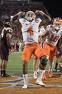 Clemson quarterback Deshaun Watson (4) celebrates after rushing for a touchdown during the second half of the Atlantic Coast Conference championship NCAA football game against Virginia Tech in Orlando, Fla., Saturday, Dec. 3, 2016. (Phelan M. Ebenhack via AP)