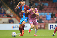 Sam Hart battles with Matty Lund during the EFL Sky Bet League 1 match between Scunthorpe United and Rochdale at Glanford Park, Scunthorpe, England on 8 September 2018.