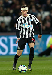 Newcastle United's Javier Manquillo bandaged after injury during the Premier League match at London Stadium.