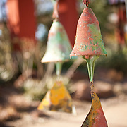 Valley Guide 012412 Phoenix, AZ<br /> <br /> Paolo Soleri bronze windbells sold at the Garden Shop at Desert Botanical Garden, located in Phoenix, AZ.<br /> <br /> Photograph by Jill Richards<br /> www.jillrichardsphotography.com Soleri windmills on display at the Desert Botanical Garden. The bronze bells are hand made. Each one is unique.