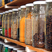Rows of spices in jars for sale in the souks of Marrakech, Morocco. They range from cooking spices to healing spices.