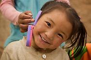 A young Tibetan girl in Ganze, Tibet (China).