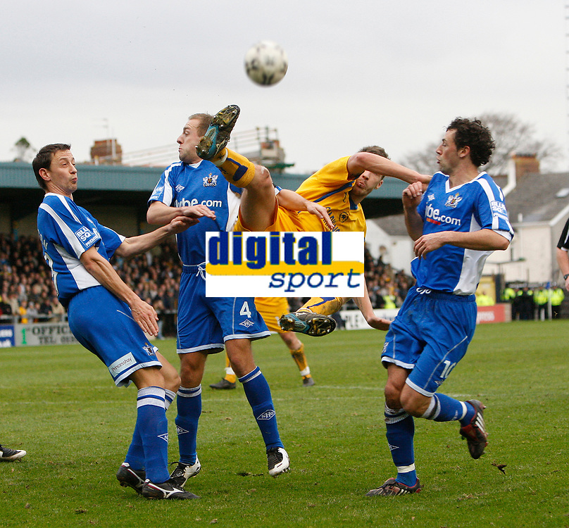 Photo: Steve Bond/Sportsbeat Images.<br />Torquay United v Exeter City. The FA Blue Square Premier. 01/01/2008. Chris Todd (C) goes for a high ball between defending players Wayne Carlisle (R) and Matthew Gill (L)
