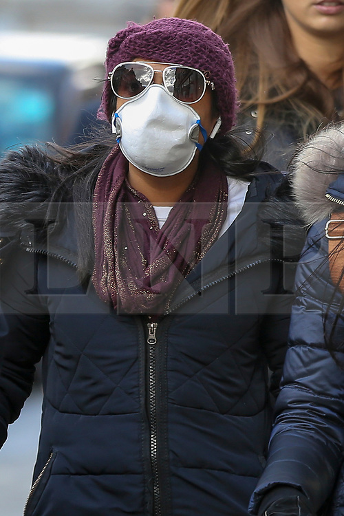 © Licensed to London News Pictures. 11/03/2020. London, UK. A shopper on London's Oxford Street wearing a surgical face mask amid an increased number of cases of Coronavirus (COVID-19) in the UK. Chancellor RISHI SUNAK has unveiled a £30bn package to help the economy get through the coronavirus outbreak in the UK. Photo credit: Dinendra Haria/LNP