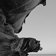 People having a nap in the rocks near Bondi Beach.