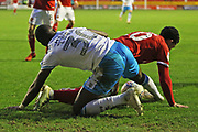 Josh Gordon and Bez Lubala compete for the ball during the EFL Sky Bet League 2 match between Walsall and Crawley Town at the Banks's Stadium, Walsall, England on 18 January 2020.