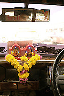 Flowers and religious symbols in a taxi, Bombay (Mumbai), Inda