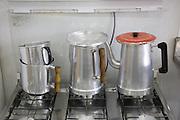Aluminium coffee pots on a stove in Cubatão town hall