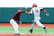21 February 2015: Hartford's Nick Campana (14) tries to beat the throw to Iona's Jimmy Guiliano (left). The Iona College Gaels played the University of Hartford Hawks in an NCAA Division I Men's baseball game at Jack Coombs Field in Durham, North Carolina as part of the Duke Baseball Classic. Hartford won the game 12-1.
