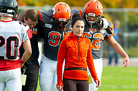 KELOWNA, BC - OCTOBER 6: Athletic therapist Sammy Levin walks off the field as Karn Sidhu #95 is assisted off the field by a coach and JJ Heaton #62 of Okanagan Sun against the VI Raiders at the Apple Bowl on October 6, 2019 in Kelowna, Canada. (Photo by Marissa Baecker/Shoot the Breeze)