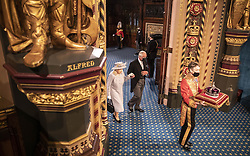 Queen Elizabeth II, accompanied by the Prince of Wales, proceeds through the Royal Gallery following her speech during the State Opening of Parliament in the House of Lords at the Palace of Westminster in London. Picture date: Tuesday May 11, 2021.