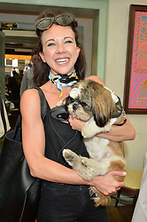 CHARLOTTE ELLIS and her dog at a party hosted by Lulu Guinness and Daphne's to launch Lulu's Designer Dog Bowl and to mark Daphne's allowing dogs through it's doors, held at Daphne's, Draycott Avenue, London on 28th June 2016.