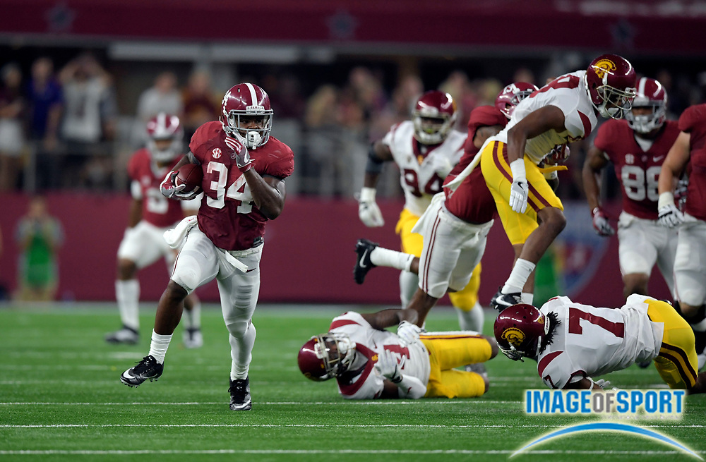 Sep 3, 2016; Arlington, TX, USA; Alabama Crimson Tide running back Damien Harris (34) runs with the ball during the first half against the USC Trojans at AT&T Stadium.