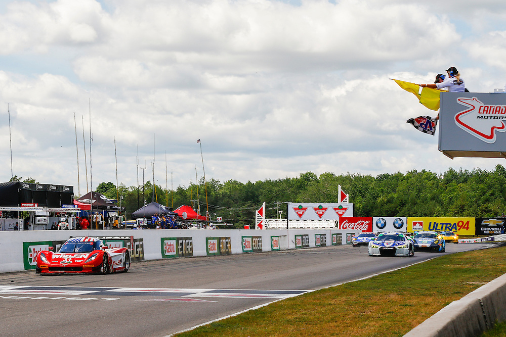 7-9 July 2016, Bowmanville, Ontario Canada<br /> Dane Cameron crosses the finish line under checker flags , giving the Whelen Engineering Action Express Daytona Prototype the win at Canadian Tire Motorsport Park<br /> ©2016, Jake Galstad<br /> LAT Photo USA