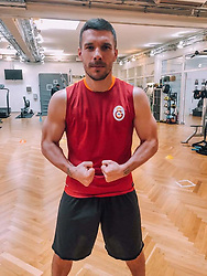 """Lukas Podolski releases a photo on Twitter with the following caption: """"""""Sevgili Veli, mutlu yıllar. Biliyorum, biraz geciktim; ama mesafelerin gerçek dostlar için engel olmadığını bilmeni isterim. 🎉🎂 #Happy48 #FormaVer #cimbom #veli https://t.co/DGwcq5V9oa"""""""". Photo Credit: Twitter *** No USA Distribution *** For Editorial Use Only *** Not to be Published in Books or Photo Books ***  Please note: Fees charged by the agency are for the agency's services only, and do not, nor are they intended to, convey to the user any ownership of Copyright or License in the material. The agency does not claim any ownership including but not limited to Copyright or License in the attached material. By publishing this material you expressly agree to indemnify and to hold the agency and its directors, shareholders and employees harmless from any loss, claims, damages, demands, expenses (including legal fees), or any causes of action or allegation against the agency arising out of or connected in any way with publication of the material."""