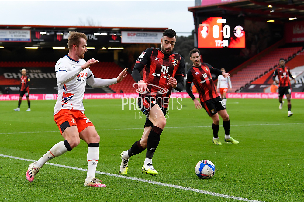 Diego Rico (21) of AFC Bournemouth battles for possession with James Bree (26) of Luton Town during the EFL Sky Bet Championship match between Bournemouth and Luton Town at the Vitality Stadium, Bournemouth, England on 16 January 2021.