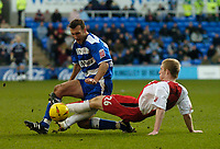 Photo. Glyn Thomas. 08/02/2005.<br /> Reading v Coventry City.<br /> Coca Cola Championship<br /> Coventry's Stuart Giddings (R) slides in to tackle Reading's Glen Little.