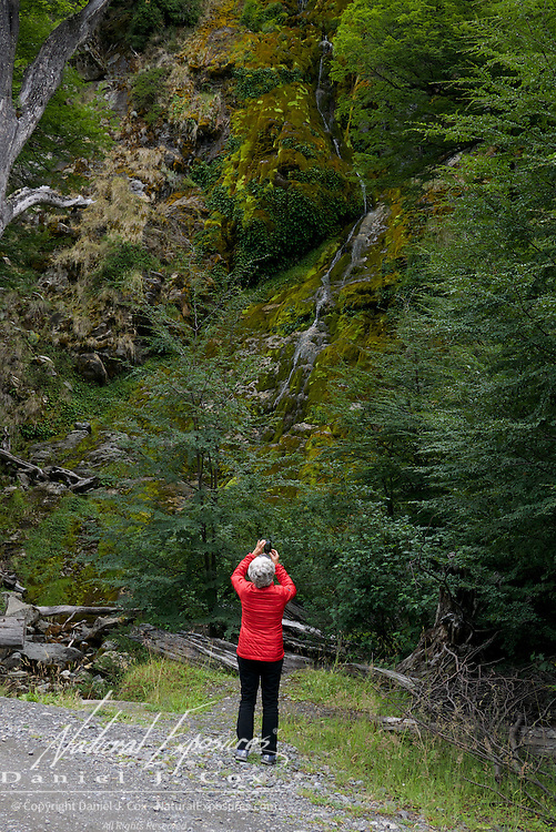 Shirley photographs one of the beautiful waterfall along the road to Laguna del Desierto lake, Patagonia, Argentina.