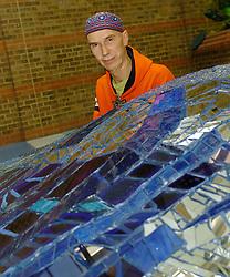 Andrew Logan<br /> Artist portrait & Wing installation <br /> Guy's Hospital Atrium, London, Great Britain<br /> October 28, 2005<br /> <br /> Photograph by ELLIOTT FRANKS
