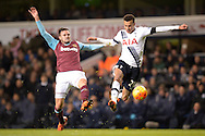 Dele Alli of Tottenham Hotspur and Carl Jenkinson of West Ham United compete for the ball. Barclays Premier league match, Tottenham Hotspur v West Ham Utd at White Hart Lane in London on Sunday 22nd November 2015.<br /> pic by John Patrick Fletcher, Andrew Orchard sports photography.