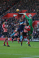 Football - 2016 / 2017 Premier League - Southampton vs. Middlesbrough<br /> <br /> Southampton's Fraser Forster punches a cross clear from Jordan Rhodes of Middlesbrough and Southampton's Cuco Martina at St Mary's Stadium Southampton England<br /> <br /> COLORSPORT/SHAUN BOGGUST