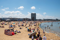 © Licensed to London News Pictures. 12/06/2021. London, UK. People bask in the sun at Margate Beach in Margate, Kent. The UK is currently experiencing an extended hot weather period. Photo credit: Ray Tang/LNP