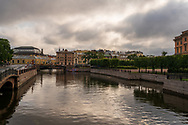 Photo of a canal in St Petersburg in the morning under threatening clouds