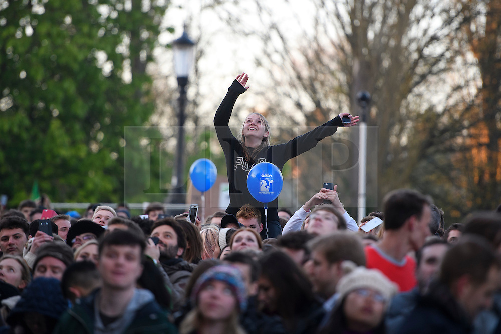 © London News Pictures. 01/05/2016. Oxford, UK.  Thousands of people line the streets to watch the May Day day celebrations in the early hours of the morning near Magdalen Bridge in Oxford, Oxfordshire. This year people were again prevented from jumping from the bridge in to the water due to serious injuries sustained at a previous years event . Photo credit: Ben Cawthra/LNP