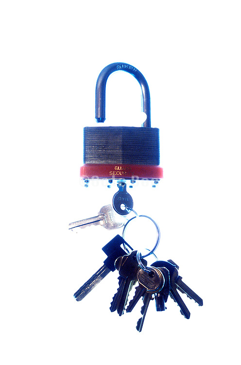 set of keys with one inserted into padlock