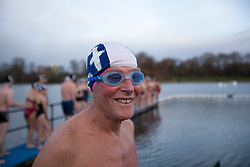 © Licensed to London News Pictures. 25/12/2011. LONDON, UK. Serpentine Swimmer Gordon Brodie, prepares to carry out his Christmas Day Swim in the Serpentine in London today (25/12/11). Members of the Serpentine Swimming Club today carried out their Christmas Day Swim, the race, known as the Peter Pan Cup after former patron and author JM Barrie, is a tradition dating back to 1864. Photo credit: Matt Cetti-Roberts/LNP