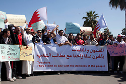© under license to London News Pictures. 20/02/2011. Teachers march around the Pearl Roundabout in Manama, Bahrain today (20/02/2011) in protest to teh Bahraini Royal Family's rule. Photo credit should read Michael Graae/London News Pictures