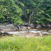 A fly fisherman tries his luck on the Ellis River in Jackson, NH